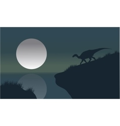 Iguanodon in riverbank with moon silhouette vector