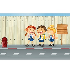 Children laughing along road vector
