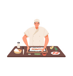 Smiling chef cooking sushi at kitchen table vector