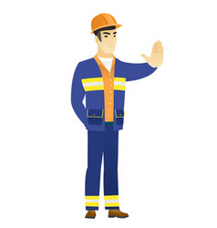 Asian builder showing stop hand gesture vector