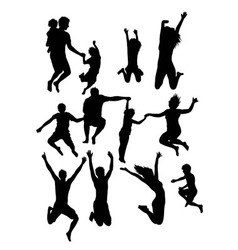 Happy jumping silhouettes vector
