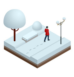 in winter a man walks through the snow in a city vector image