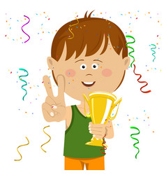Little boy holding gold cup trophy vector