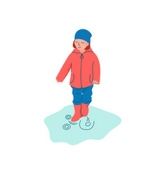 Boy dressed in seasonal clothes playing in puddle vector