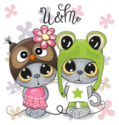 Kittens boy and girl on a flowers background vector