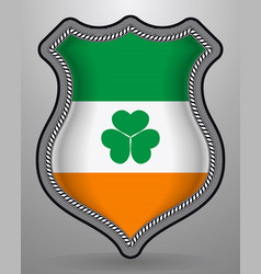 Ireland flag with shamrock badge and icon vector
