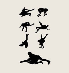 Wrestlers silhouettes vector