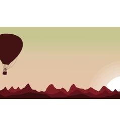 Silhouette of air balloon on sunset sky vector