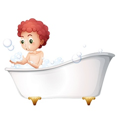 A young boy playing at the bathtub while taking a vector image