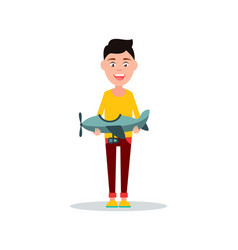 small boy holding toy plane vector image