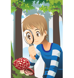 boy with magnifying glass vector image