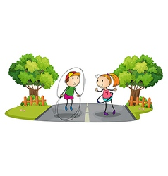 Children playing in the middle of the street vector