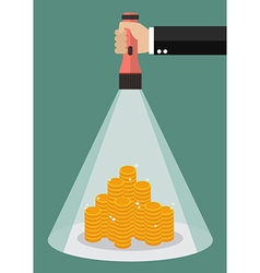Hand holding flashlight glow to the money vector image