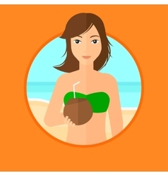 Woman drinking coconut cocktail on the beach vector