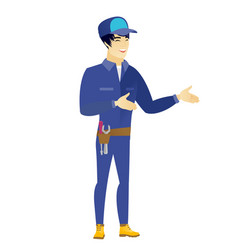 young asian happy mechanic gesturing vector image