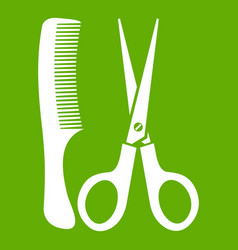 scissors and comb icon green vector image