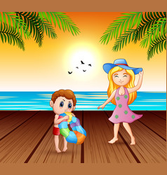 mother and her son having fun at seaside vector image