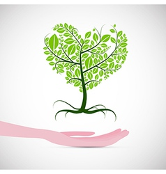 Heart Shaped Abstract Green Tree in Human Hand vector