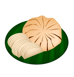 Sweet Ripe Santol Fruit on Green Banana Leaf vector