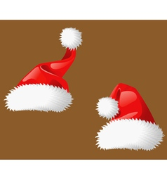 Two Santa Clous christmas hats vector image