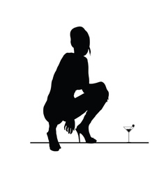 Woman sensual silhouette with martini glass vector