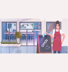 Waitress taking off face mask standing near open vector