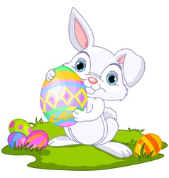cute easter bunny carrying egg vector image