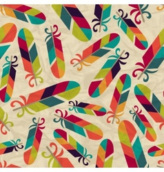 Seamless pattern with feathers on crumpled paper vector image