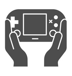 Gamepad in hands solid icon joypad in arms vector