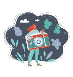 cartoon woman holding a big photo camera on dark vector image