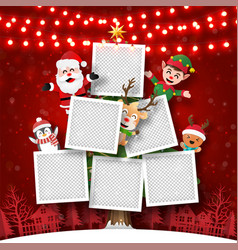 photo frame on christmas tree with santa claus vector image