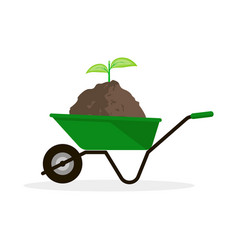 wheelbarrow with pile of soil and green sprout vector image