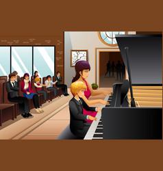 boy in piano recital vector image