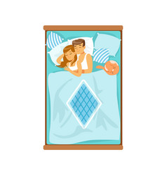 embracing young couple sleeping on the bed vector image