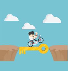 Businessmen drive a bike through steep cliffs vector