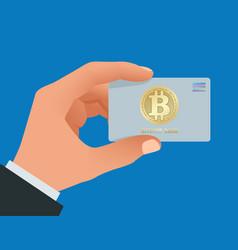 A man s hand holds bitcoin debit card account vector
