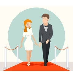Celebrities couple walking on a red carpet vector