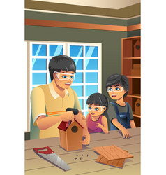 Father kids making birdhouse vector