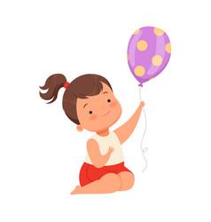 Girl holding a balloon on a vector