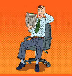 Pop art shocked businessman reading newspaper vector