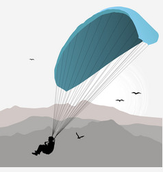 Paraglider hovers over the mountain vector
