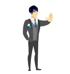 asian groom showing stop hand gesture vector image
