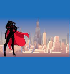 superheroine standing tall city silhouette vector image