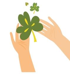 Hands holding clover leaf vector image