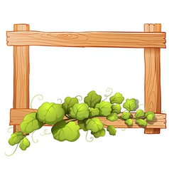 A wooden frame with a leafy plant vector