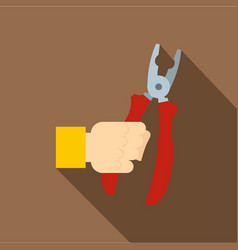 hand holding pliers with red handles icon vector image