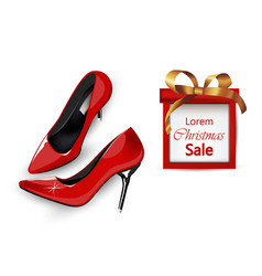 red stiletto shoes with christmas gift box vector image