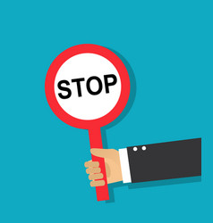hand holds a round stop sign vector image