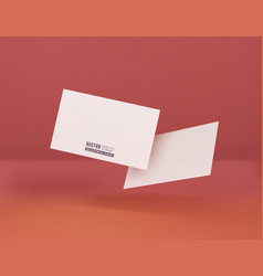 two white business cards on a corral background vector image