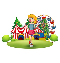 A tall young girl at the carnival vector image